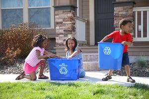 Three-children-putting-items-into-recycle-bin-93099254_2700x1800